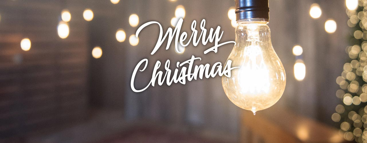 Merry Christmas - Image of barn with Edison-style lighting and lit Christmas tree