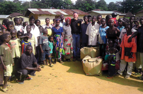 Jon Purple visited Liberia to donate thousands of shoes.