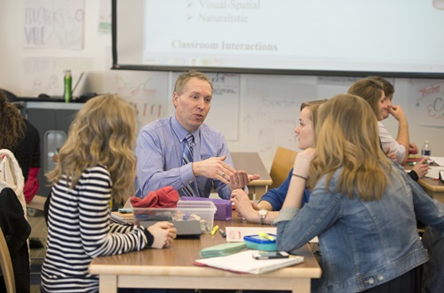 Dr. Ervin discusses education concepts with students