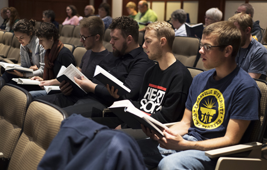 students participate in hymn sing
