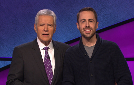 CU grad pictured with Alex Trebek