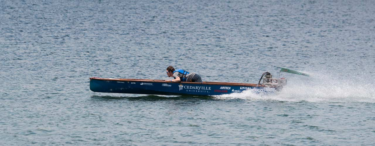 engineering student drives solar boat