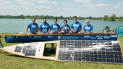 Solar splash team poses with boat