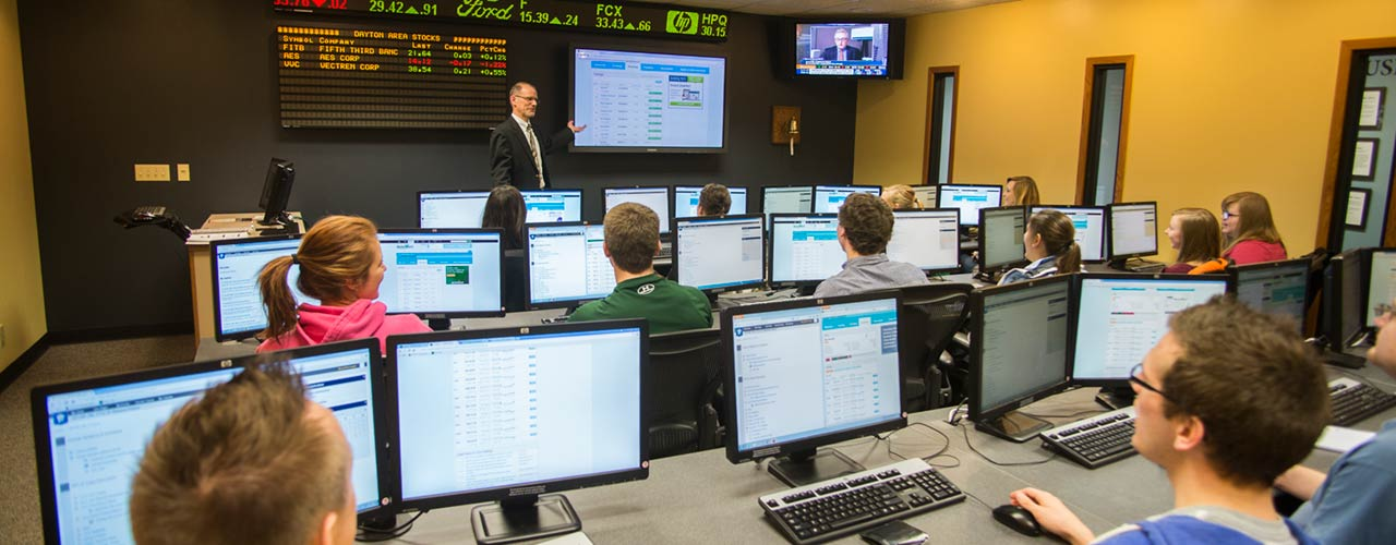 professor lectures in CU's Key Bank Trading Center