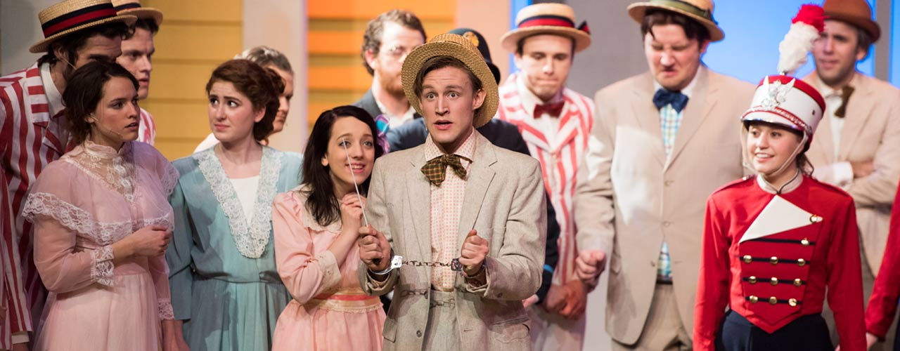 Members of the Music Man cast perform on stage
