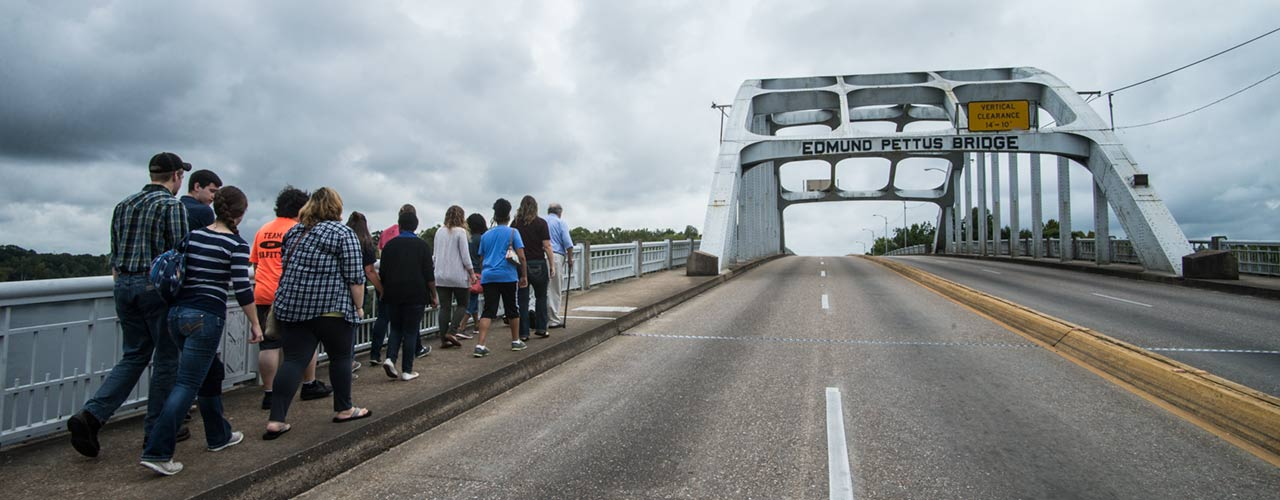 A group from Cedarville University walks across the Edmund Pettus Bridge in Selma, Alabama.