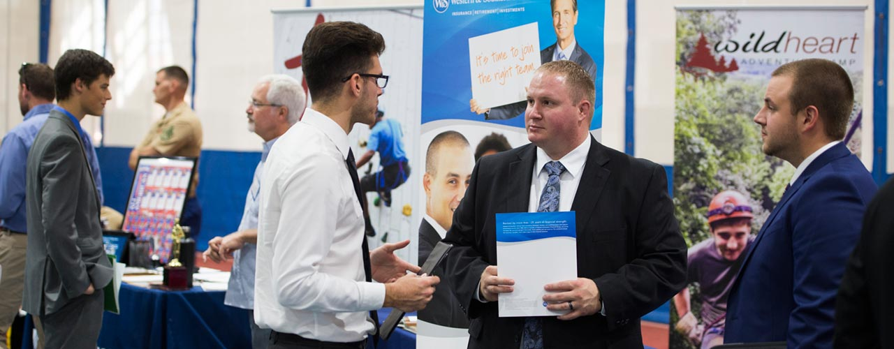Student talks with recruiters during past fall career fair