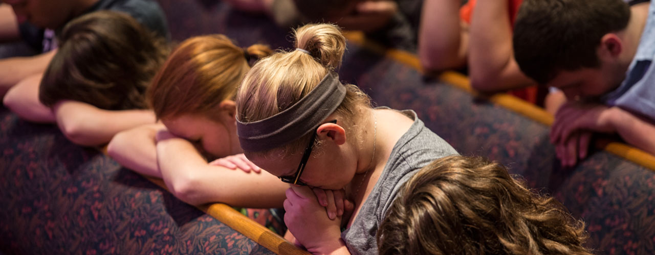 Students praying.