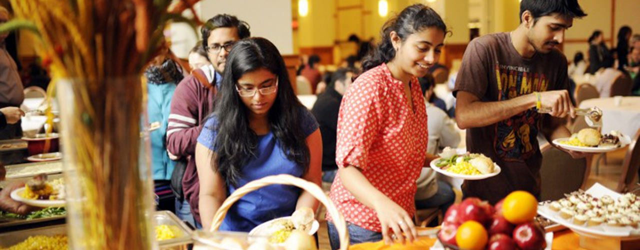 International students eat Thanksgiving meal through CBF.