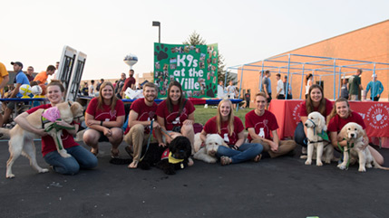 K9s at the Ville students pose with puppies.