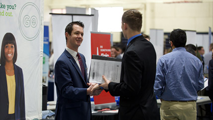 Student talks with recruiter at Cedarville career fair