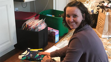 Julia Gardner boxes pajamas for pediatric cancer patients.