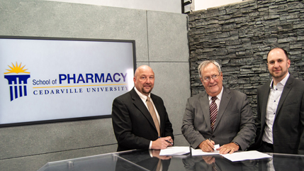 Dr. Marc Sweeney, Dr. Ernie Boyd, and Dr. Justin Cole signing the memorandum of understanding between the Ohio Pharmacists Association and Cedarville's Center for Pharmacy Innovation.