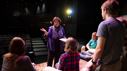 Dr. Diane Merchant speaking with student actors.