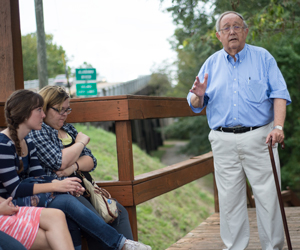 Dr. Murray Murdoch talking to students on the Civil Rights Bus Tour near the Edmund Pettus Bridge