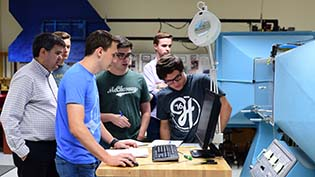 Engineering students working on equipment
