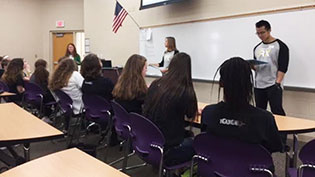 Pharmayc students in classroom talking to students in seats