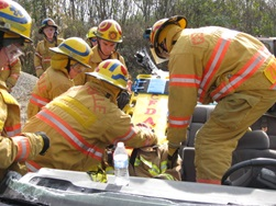 EMT students learning vehicle rescue procedures