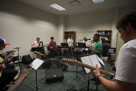 Students practice playing in a band together