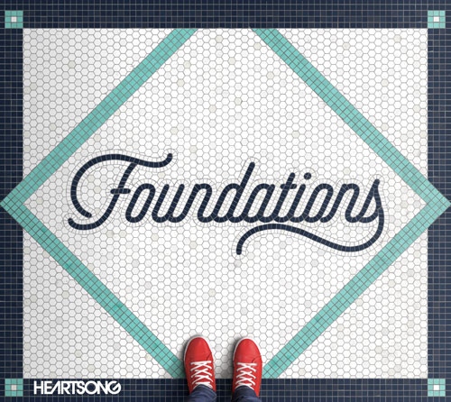 A person with red shoes stands on a mosaic tile floor with the title for the new HeartSong album foundations on it.
