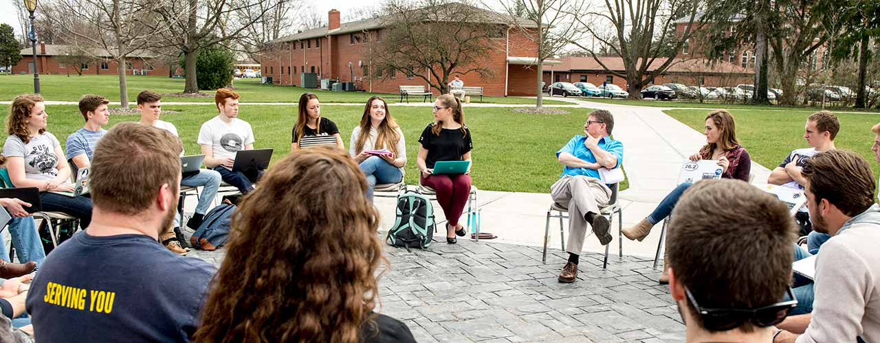 Marketing class discusses outside