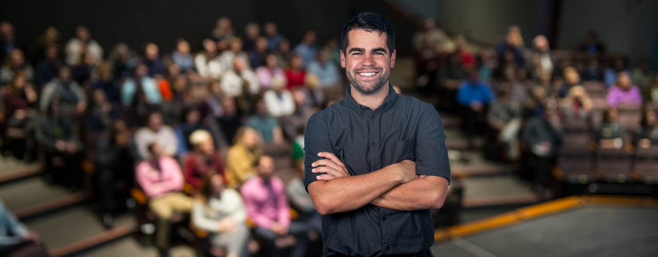 Man smiling in lecture hall