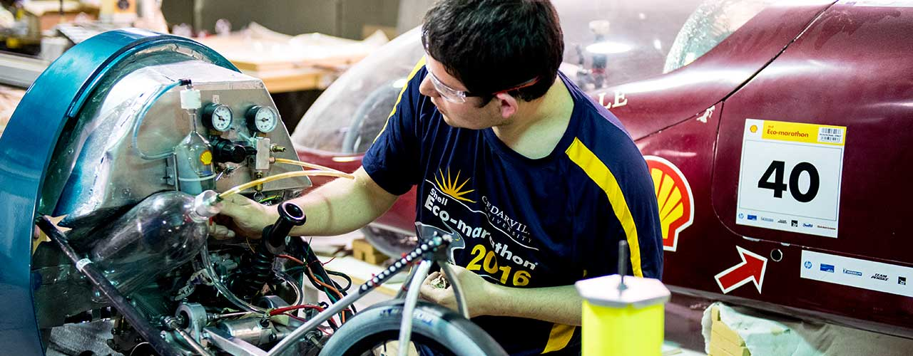 Male engineering student working on a supermileage car in Cedarville's Engineering Projects Lab