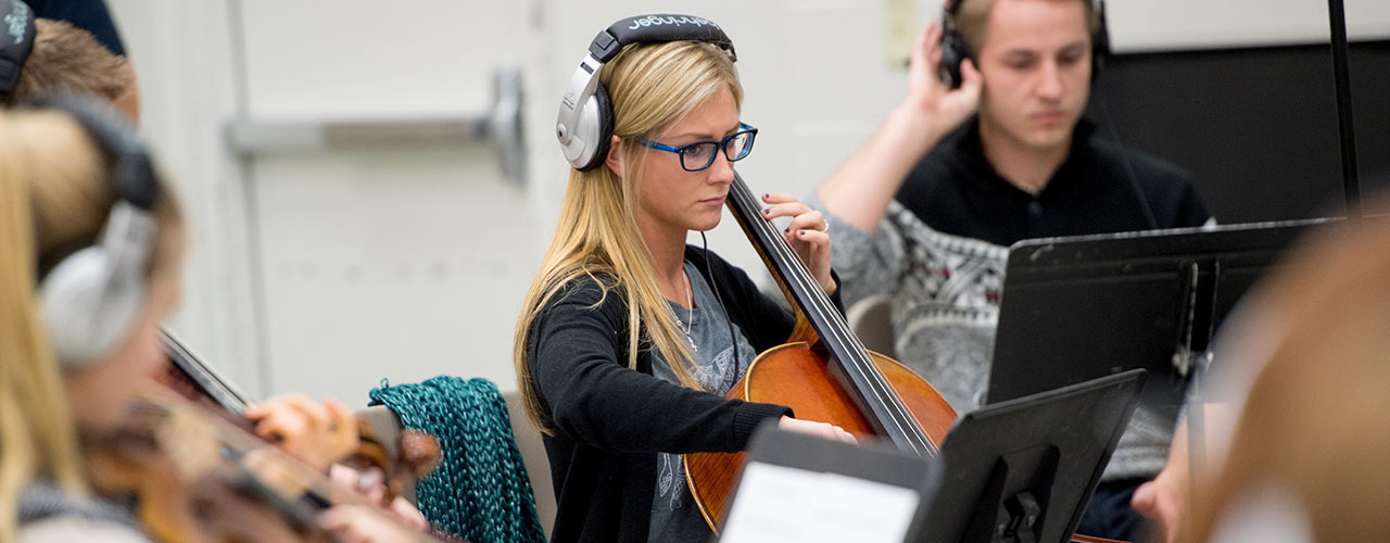 Female music major plays the cello
