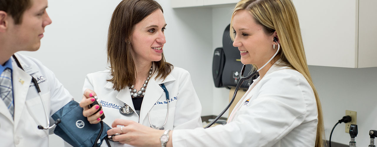 Female pharmacy majors take blood pressure