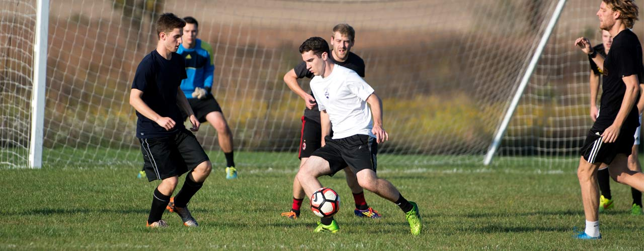 An intramural soccer team plays in a field