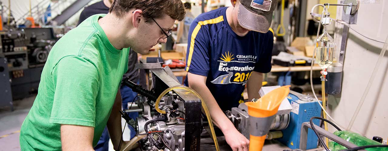 Male mechanical engineering students work on a project in Cedarville's Engineering Projects Lab