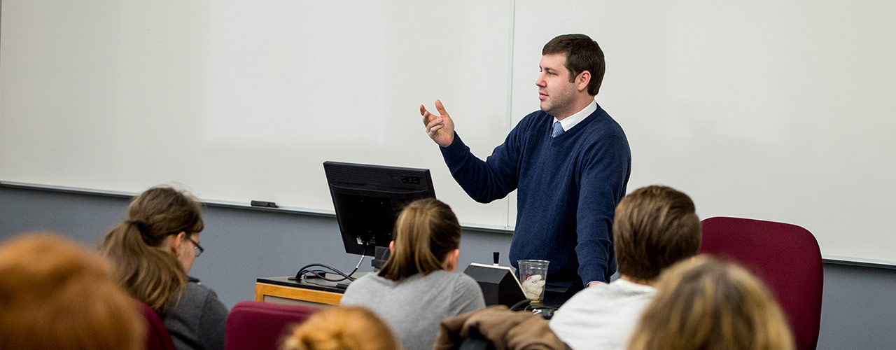 Honors professor lectures to students in class