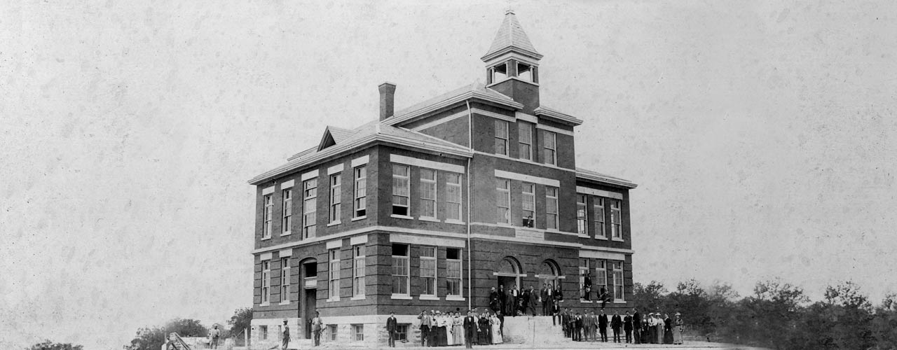Black and white photo portrays Founder's Hall from 1887