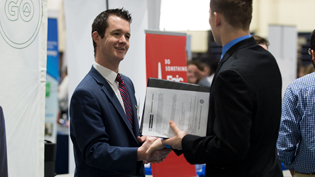 Employer talks with student during career fair