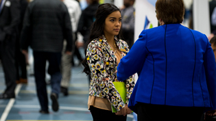 A female student talks with a potential employer at one of Cedarville's career fairs