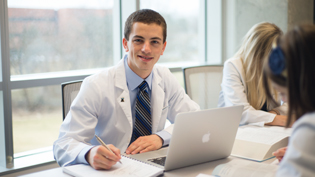 Male pharmacy student using a laptop