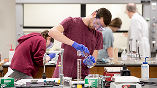 Student performs a chemistry experiment in Cedarville's state of the art chemistry labs.