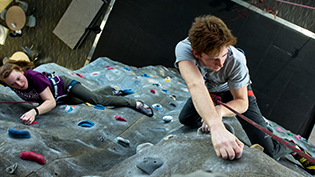 Students climb up Cedarville's 36 foot indoor climbing wall