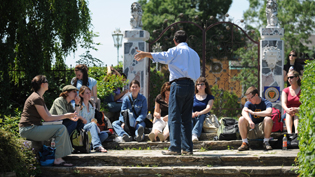 A professor instructs a class at a study abroad location