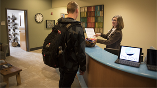 Picture of conversation at cove front desk
