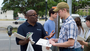 A man and student having a discussion at a civil rights event