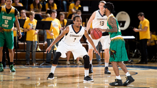 Cedarville University basketball player defending the home court
