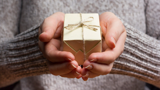 Person holding a small present