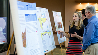 Student presents her research to a judge
