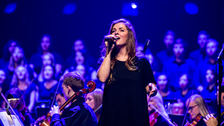 Female student singing at Cedarville's night of worship event