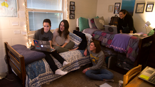Four female students hanging out in one of Cedarville's dorm rooms