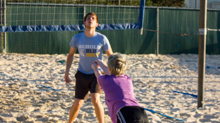 A student dives for the ball on Cedarville's sand volleyball court