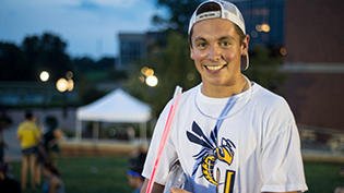 A male Cedarville student smiles at a campus event