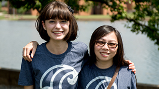 Two female students wearing Cove t-shirts