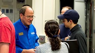 An engineering professor talks with a prospective student